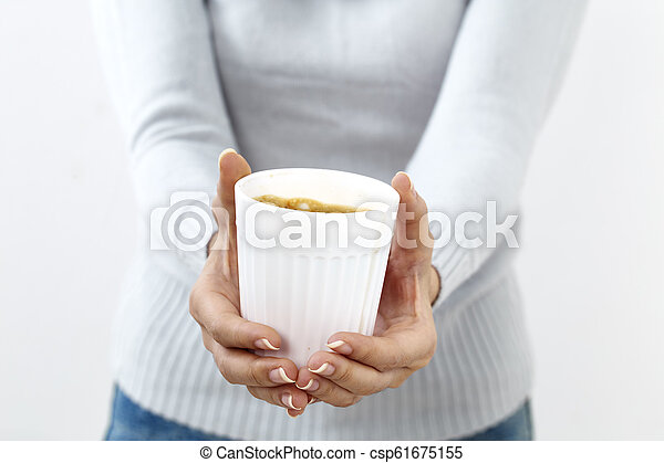 hand holding a coffee cup - csp61675155