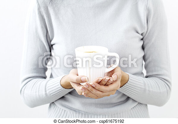 hand holding a coffee cup - csp61675192
