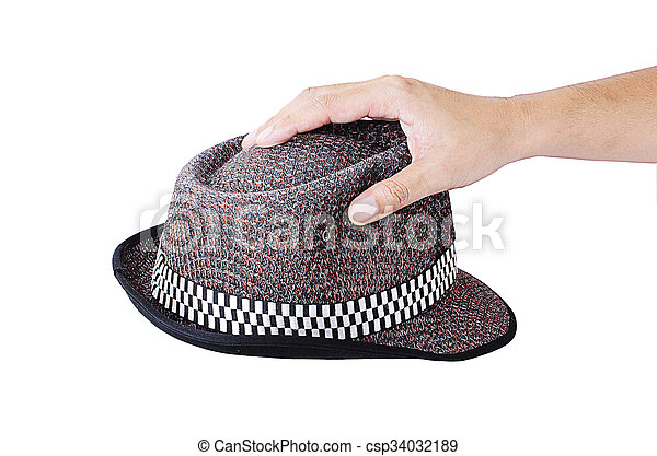 Hand holding a hat Isolated on white backgrounds - csp34032189