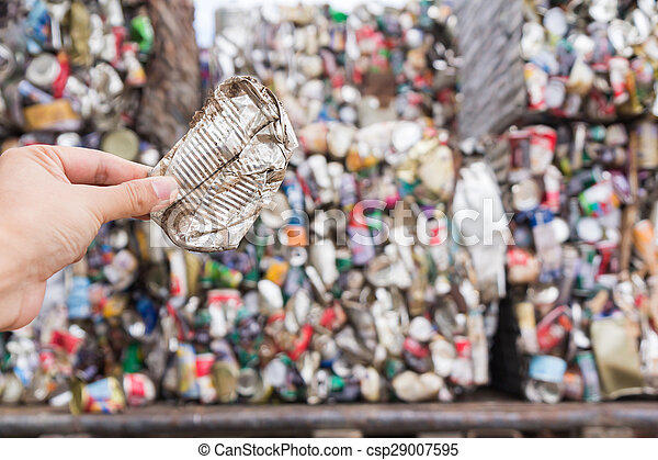 Hand holding aluminum can for recycle - csp29007595