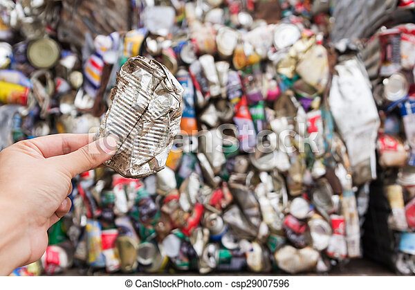 Hand holding aluminum can for recycle - csp29007596