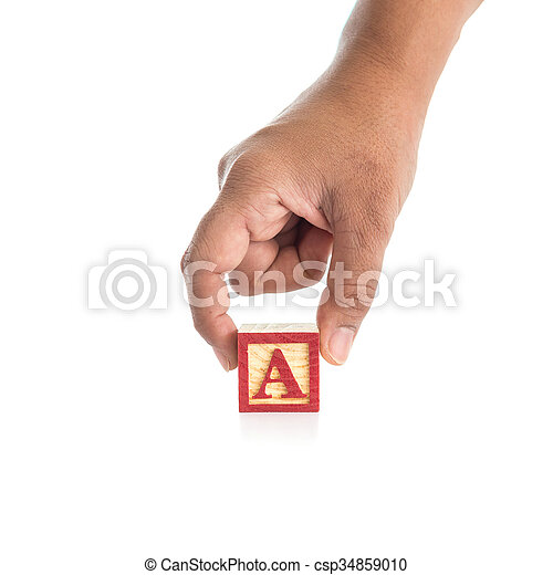 "Hand holding colorful alphabet blocks ""A"" isolated on white - csp34859010"