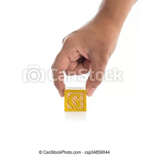 "Hand holding colorful alphabet blocks ""G"" isolated on white - csp34859044"
