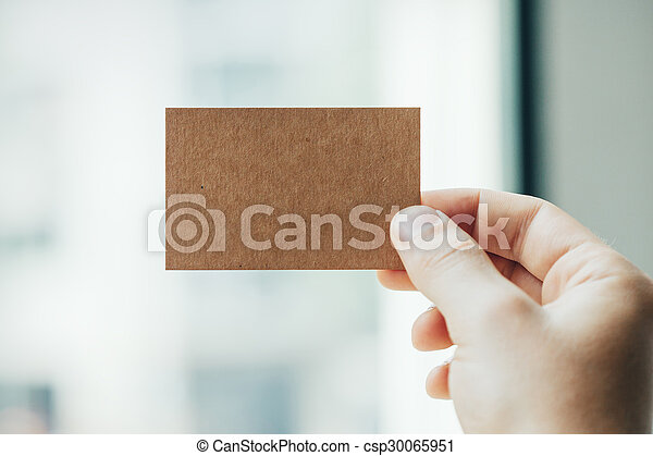 Hand holding craft business card on the blurred background hand hand holding craft business card on the blurred background csp30065951 colourmoves