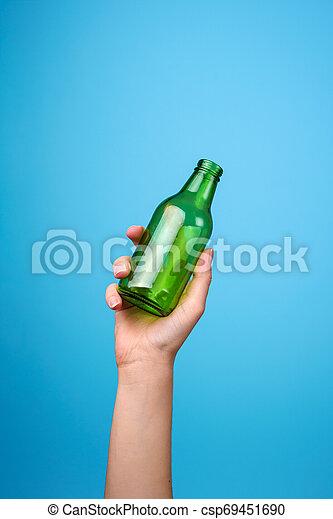 hand holding glass bottle - csp69451690