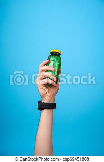 hand holding glass bottle - csp69451808