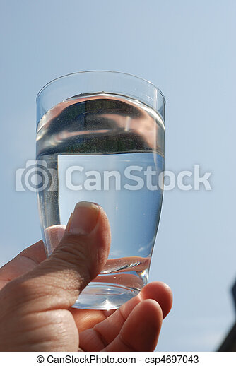 Hand holding glass of water - csp4697043