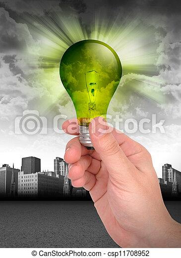 Hand Holding Green Energy Light Bulb - csp11708952