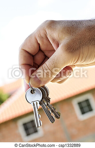 Hand holding keys - csp1332889