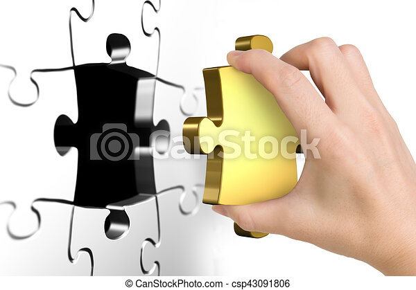 Hand holding last missing golden puzzle piece - csp43091806