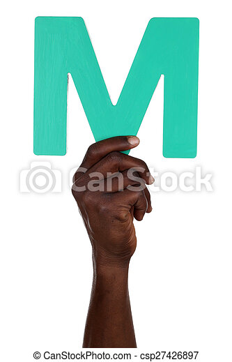 Hand holding letter M from alphabet - csp27426897