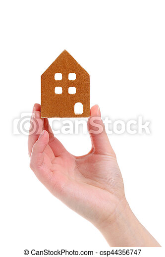 Hand holding miniature model of house - csp44356747