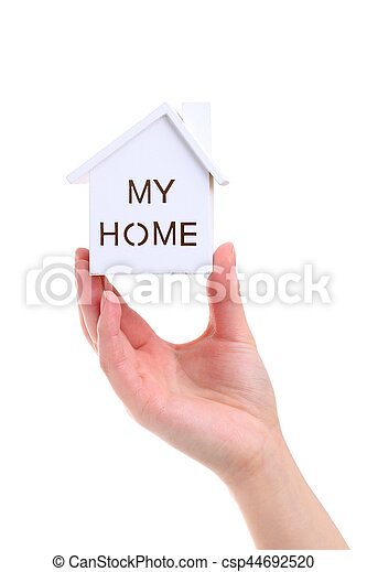Hand holding miniature model of house - csp44692520