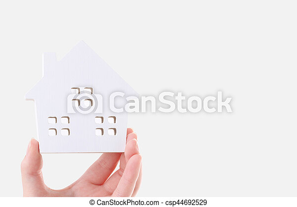Hand holding miniature model of house - csp44692529