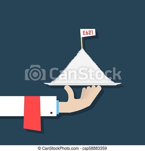 hand holding pile of sodium glutamate - csp58883359