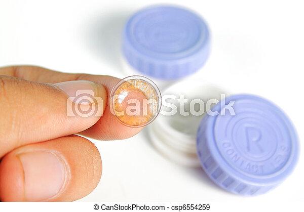 hand holding soft lense - csp6554259