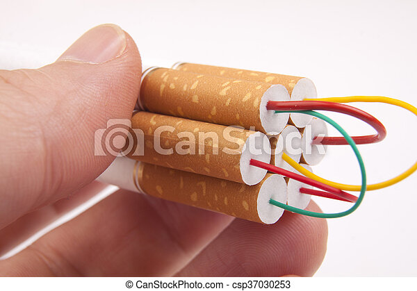 Hand holding stack of Cigarettes - csp37030253