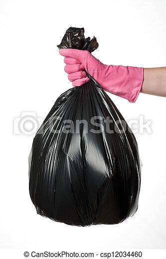 Hand holding trash bag - csp12034460