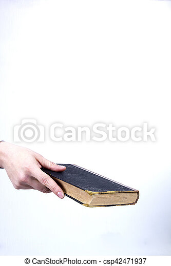 Hand holds an old book - csp42471937