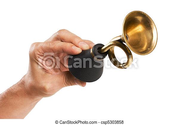 hand holds an old car horn - csp5303858