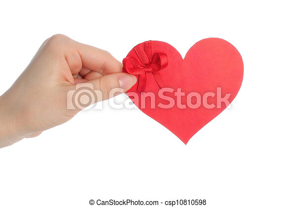 Hand holds paper heart with bow on white background - csp10810598