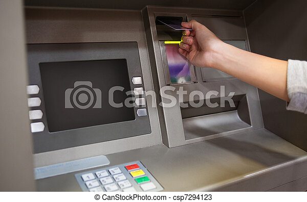Hand inserting a credit card - csp7294123