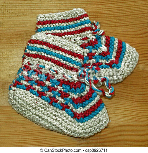 Hand knitted baby booties - csp8926711