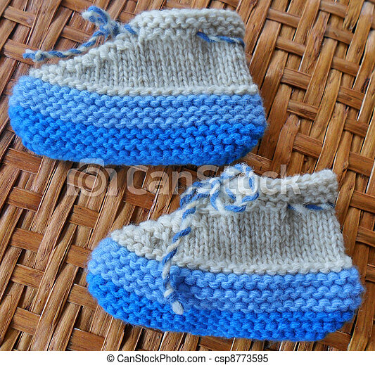 Hand knitted baby booties - csp8773595