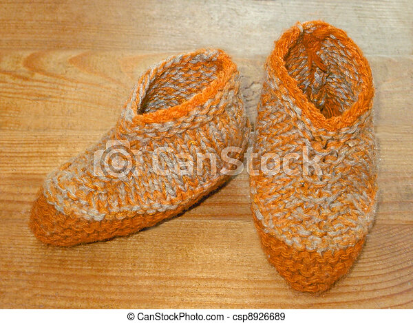 Hand knitted baby booties - csp8926689