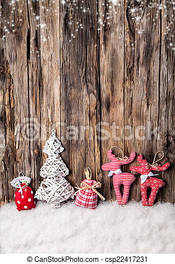Hand made traditional christmas decoration on wood - csp22417231