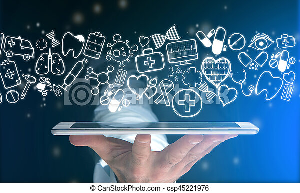 Hand of a man holding tablet with medical icons all around - csp45221976