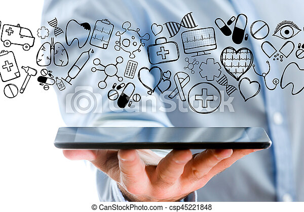 Hand of a man holding tablet with medical icons all around - csp45221848
