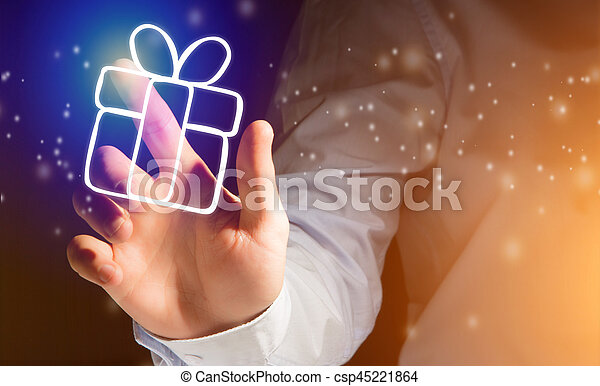 Hand of a man touching futuristic interface with christmas icons - csp45221864