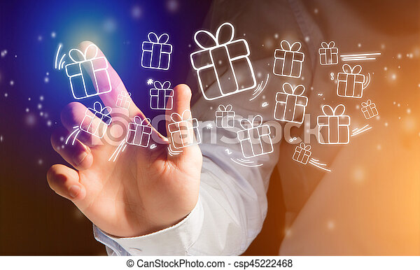 Hand of a man touching futuristic interface with christmas icons - csp45222468