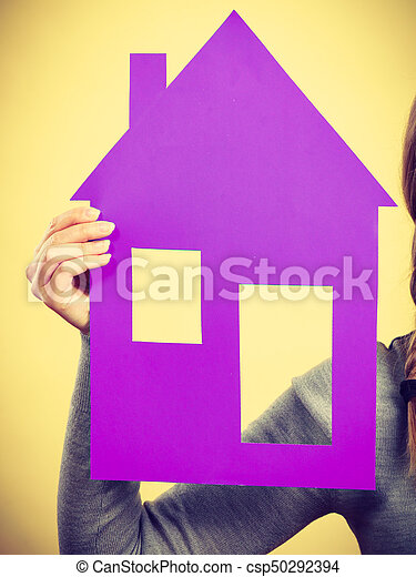 Hand of woman holding house model. - csp50292394