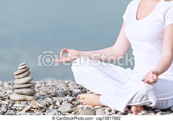 hand of  woman meditating in a yoga pose on beach - csp15817662