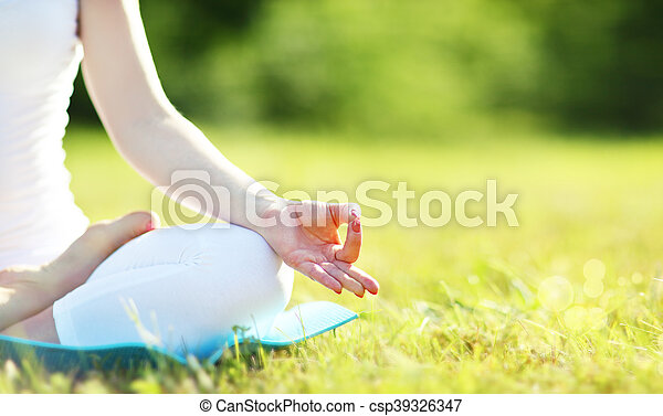 hand of woman meditating in lotus position practicing yoga - csp39326347
