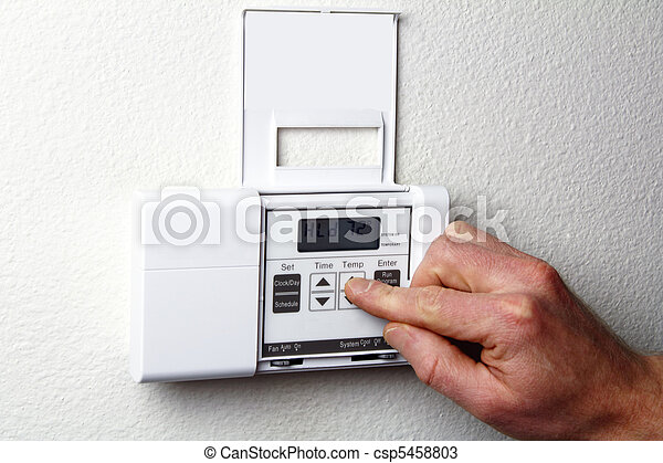Hand on Thermostat - csp5458803