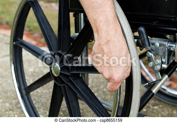 Hand On Wheelchair - csp8655159