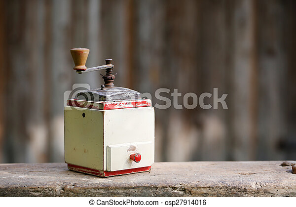 Hand-operated old wooden coffee or spices grinder - csp27914016