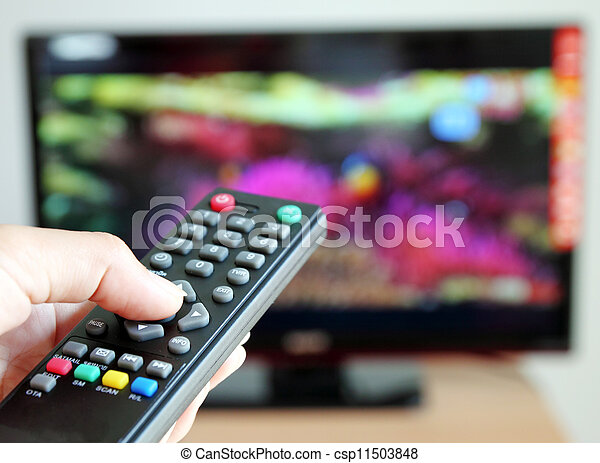 Hand pointing a tv remote control towards the television - csp11503848