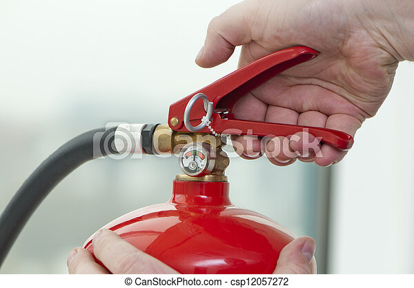 hand presses the trigger fire extinguisher - csp12057272