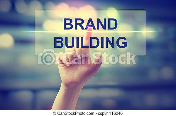 Hand pressing Brand Building  - csp31116246