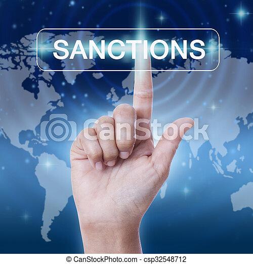 hand pressing sanctions word button. business concept - csp32548712