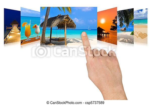 Hand scrolling summer beach images - csp5737589