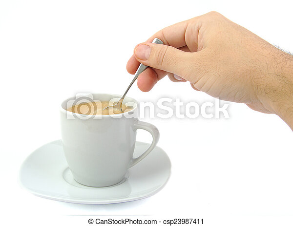 Hand stirring a cup of coffee - csp23987411
