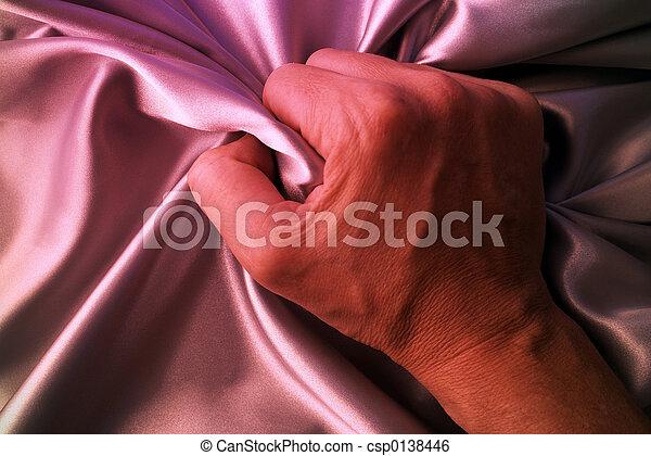Hand Man Grabbing Satin Sheet On The Bed