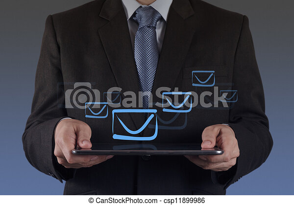 hand use tablet computer with email icon - csp11899986