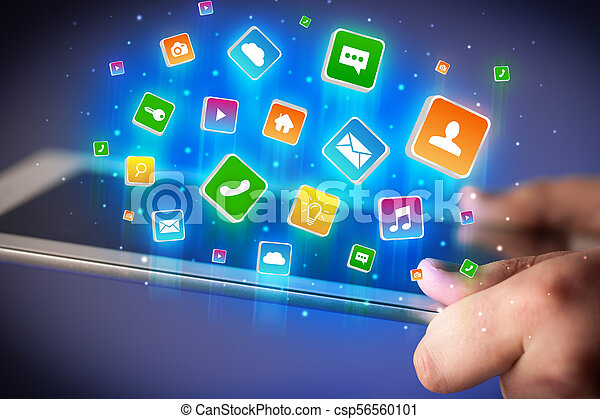 Hand using tablet with application icons flying around - csp56560101