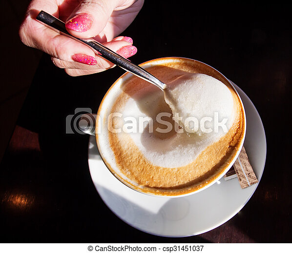 Hand with a cup of coffee - csp31451037